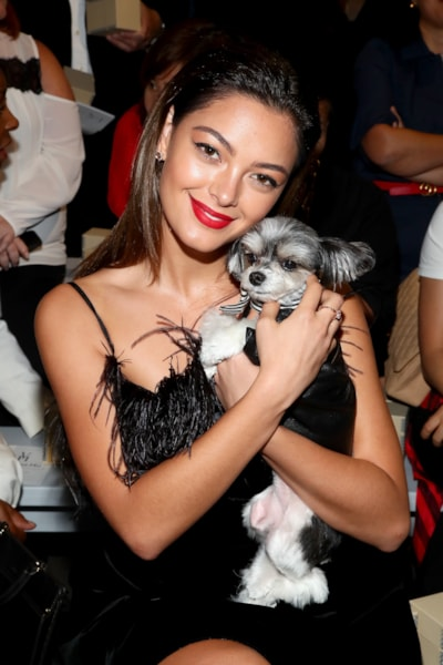 NEW YORK, NY - SEPTEMBER 07:  Demi-Leigh Nel-Peters and Tinker Belle the dog attend the Vivienne Hu front row during New York Fashion Week: The Shows at Gallery II at Spring Studios on September 7, 2018 in New York City.  (Photo by Astrid Stawiarz/Getty Images for Vivienne Hu)