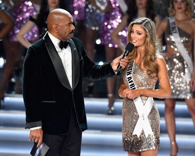 LAS VEGAS, NV - NOVEMBER 26:  Television personality and host Steve Harvey (L) speaks with Miss South Africa 2017, Demi-Leigh Nel-Peters after she is named a top 16 finalist during the 2017 Miss Universe Pageant at The Axis at Planet Hollywood Resort & Casino on November 26, 2017 in Las Vegas, Nevada.  (Photo by Frazer Harrison/Getty Images)