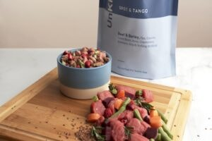 spot & tango unkibble with raw chicken and veggie ingredients